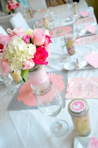 Baby Shower centerpiece, pink flowers, candles, pram theme